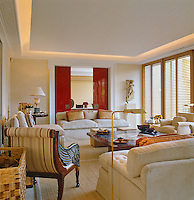 The comfortable living room is separated from the adjoining dining room by red-lacquered sliding doors