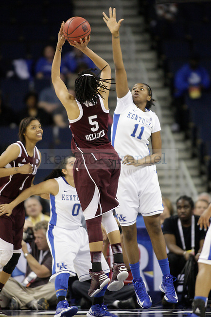 UK center DeNesha Stallworth jumps to block a shot by TAMU forward Kristi Bellock during the second half of the University of Kentucky women's basketball game vs. Texas A&M University during the SEC Tournament Championship Game at The Arena at Gwinnett Center in Duluth, Ga., on Sunday, March 10, 2013. UK lost 75-67. Photo by Tessa Lighty | Staff
