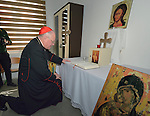 Cardinal Timothy Dolan, the archbishop of New York, prays in the chapel of the Al Bishara School run by the Dominican Sisters of St. Catherine of Siena in Ankawa, near Erbil, Iraq, on April 9, 2016. <br /> <br /> Dolan, chair of the Catholic Near East Welfare Association, is in Iraqi Kurdistan with other church leaders to visit with Christians and others displaced by ISIS. The Dominican Sisters were themselves displaced by ISIS, and have established schools and other ministries among the displaced.<br /> <br /> CNEWA is a papal agency providing humanitarian and pastoral support to the church and people in the region.