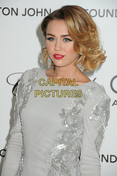 Miley Cyrus.20th Annual Elton John Academy Awards Viewing Party held at West Hollywood Park, West Hollywood, California, USA..February 26th, 2012.oscars half length dress grey gray silver red lipstick paillettes dangling earrings .CAP/ADM/BP.©Byron Purvis/AdMedia/Capital Pictures.