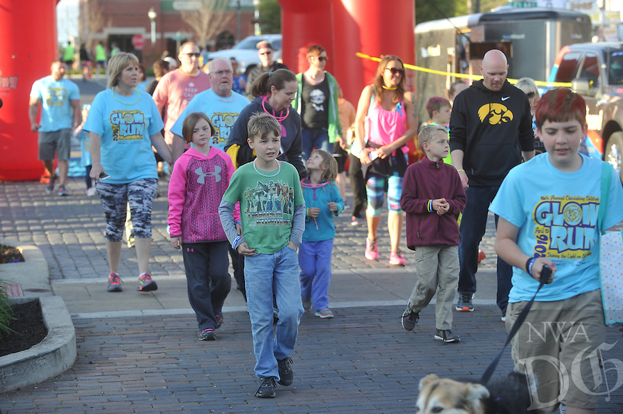 NWA Democrat-Gazette/MICHAEL WOODS &bull; @NWAMICHAELW<br /> The United Way Cherishing Children Glow Run Friday April 15, 2016 in downtown Rogers. The glow-themed run is a family- friendly event that raises awareness to empower children to find their voice and speak up against abuse.