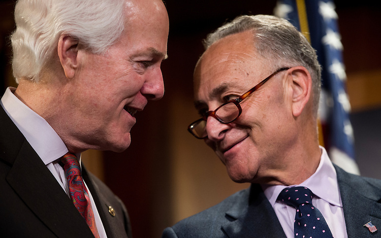 UNITED STATES - APRIL 29: Senators John Cornyn, R-Texas, left, and Chuck Schumer, D-N.Y., talk during as Senate Judiciary Committee members hold a news conference in the Capitol on bipartisan patent reform legislation on Wednesday, April 29, 2015. (Photo By Bill Clark/CQ Roll Call)