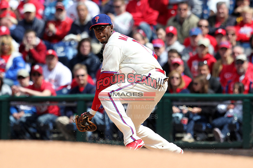 Philadelphia Phillies first baseman John Mayberry #15 takes a throw in the dirt during their home opener against the Miami Marlins at Citizens Bank Park on April 9, 2012 in Philadelphia, Pennsylvania.  Miami defeated Philadelphia 6-2.  (Mike Janes/Four Seam Images)