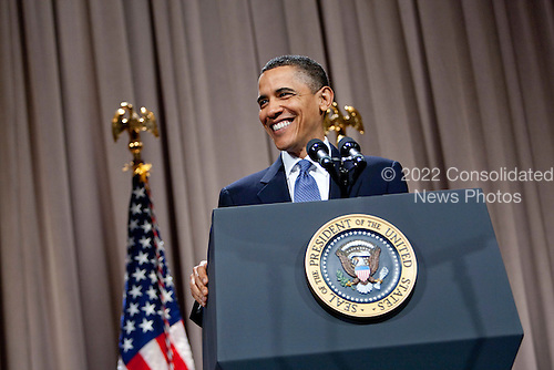 """United States President Barack Obama smiles during a speech about financial reform at Cooper Union in New York, U.S., on Thursday, April 22, 2010. Obama called on the financial industry to drop its """"furious efforts"""" to fight his regulation plan, saying a failure to impose tougher rules on the market will put the U.S. economic system at risk. .Credit: Daniel Acker - Pool via CNP"""