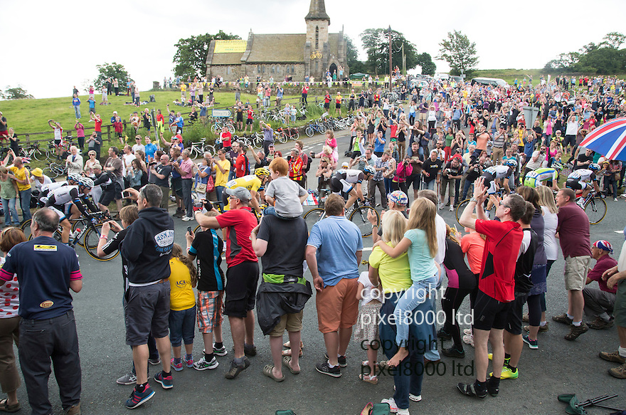 Grand Depart - Tour de France 2014<br /> Yorkshire England.<br /> Second stage passes through &quot;Blubberhouses Moor&quot;<br /> on the road from Harrogate<br /> Leaders pass through<br /> <br /> <br /> <br /> Pic by Gavin Rodgers/Pixel 8000 Ltd