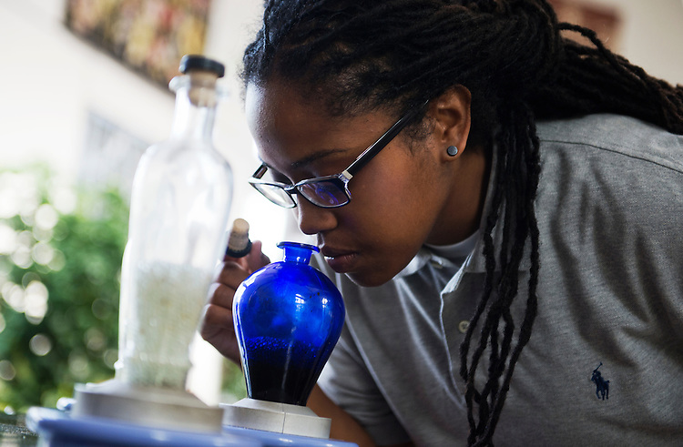 UNITED STATES - JUNE 03: Aesha Wingate-Bey of the District smells a sample of thyme at a fragrance display in the U.S. Botanic Garden. (Photo By Tom Williams/CQ Roll Call)