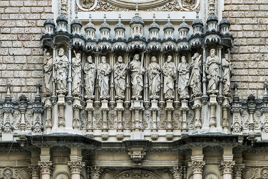 Exterior sculpture of Jesus and the twelve apostles, Santa Maria de Montserrat, Monistrol de Montserrat,  Catalonia, Spain.