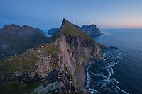 Wild mountain camping on narrow ridge, Moskenesøy, Lofoten Islands, Norway