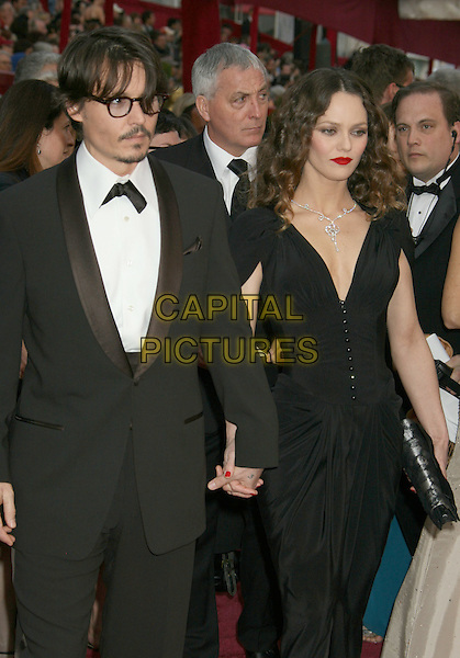 JOHNNY DEPP & VANESSA PARADIS.The 80th Annual Academy Awards Arrivals held at the Kodak Theatre, Hollywood, California, USA,.24 February 2008..oscars half length glasses  white shirt black suit jacket bow tie black dress holding hands couple.CAP/ADM/RE.?Russ Elliot/Admedia/Capital Pictures