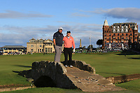 Shane Lowry (IRL) and Gerry McManus (AM) on the Swilken bridge on the 18th during Round 3 of the Alfred Dunhill Links Championship 2019 at St. Andrews Golf CLub, Fife, Scotland. 28/09/2019.<br /> Picture Thos Caffrey / Golffile.ie<br /> <br /> All photo usage must carry mandatory copyright credit (© Golffile | Thos Caffrey)