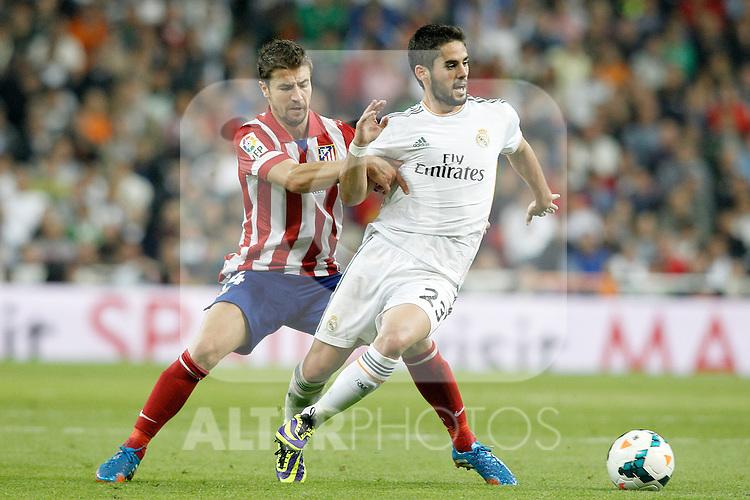Real Madrid's Isco (r) and Atletico de Madrid's Gabi Fernandez during La Liga match.September 28,2013. (ALTERPHOTOS/Acero)