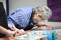 """Donna Mayberry of Rogers blows on an art piece she is making, Sunday, February 9, 2020 at Heart & Soul Studios NWA in Rogers. Check out nwaonline.com/200210Daily/ for today's photo gallery.<br /> (NWA Democrat-Gazette/Charlie Kaijo)<br /> <br /> The studio held their first """"Bring Your Grandparents to Paint Day"""" event. Marie Haley, owner of the studio, wanted to create an opportunity for grandparents and their grand kids to spend some time together to do something creative and unique. """"They're painting themselves. Usually grownups just come and watch,"""" said Haley. The next event will be in March and they plan to hold the event each month moving forward."""