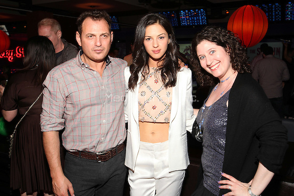NEW YORK - APRIL 22: (L-R) Lev Gorn, Annet Mahendru, and guest attend the FX Networks Upfront Bowling Party at Lucky Strike on April 22, 2015 in New York City. Credit: PGCS/MediaPunch