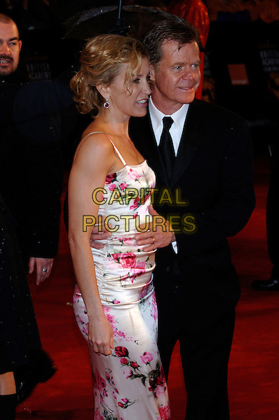 FELICITY HUFFMAN & WILLIAM H. MACY.Arrivals at The Orange British Academy Film Awards .BAFTA's at the Odeon Leicester Square, London, England.February 19th, 2006.Ref: PL.bafta baftas half length celebrity couple husband wife white pink floral print dress profile.www.capitalpictures.com.sales@capitalpictures.com.© Capital Pictures.