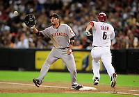 Jul. 23, 2010; Phoenix, AZ, USA; San Francisco Giants first baseman Travis Ishikawa makes the play to get out Arizona Diamondbacks base runner Stephen Drew at Chase Field. Mandatory Credit: Mark J. Rebilas-