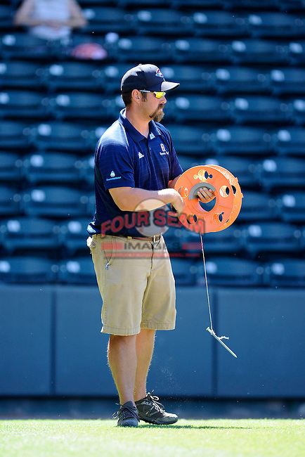 Head groundskeeper Greg Burgess of the Greenville Drive works to draw the foul lines before a game on Sunday, June 28, 2015, at Fluor Field at the West End in Greenville, South Carolina. Charleston won 12-9. (Tom Priddy/Four Seam Images)