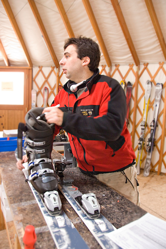 Lonnie Glieberman manager of Mount Bohemia ski resort in Michigans Upper Peninsula works in the rental yurt setting up skis for a customer.