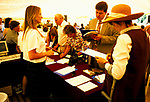 Country House Auction at Newnham Hall Northamptonshire 1994. Chritsies auction 1990s UK. <br /> <br /> PEOPLE FILL IN REGISTRATION FORMS AT DESK FOR COUNTRY HOUSE AUCTION,,