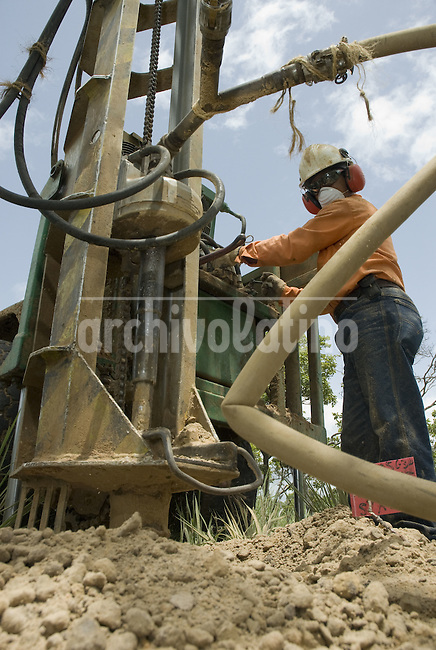 Workers of Venezuelan state owned company PDVSA dig a well looking for new oil location. Exploring new oil sources is a complex and very costly field of the oil industry.