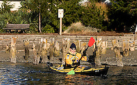 Reed Waite of the Washington Water Trails Association paddles away from a public access point on Salmon Bay in Seattle Saturday Dec. 8, 2007.