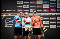 Junior Women road race podium:<br /> 1/ Megan Jastrab (USA)<br /> 2/ Julie de Wilde (BEL)<br /> 3/ Lieke Nooijen (NED)<br /> <br /> road race from Doncaster to Harrogate (86km)<br /> 2019 Road World Championships Yorkshire (GBR)<br /> <br /> ©kramon