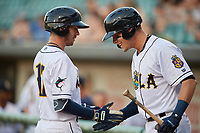New Orleans Baby Cakes Matt Snyder (33) congratulates JT Riddle (17) after hitting a home run during a Pacific Coast League game against the Oklahoma City Dodgers on May 6, 2019 at Shrine on Airline in New Orleans, Louisiana.  New Orleans defeated Oklahoma City 4-0.  (Mike Janes/Four Seam Images)