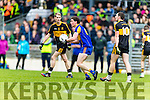 Gavin O'Shea Dr Crokes in action against Tadhg Morley Kenmare District in the Senior County Football Championship final at Fitzgerald Stadium on Sunday.