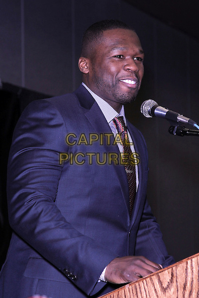 CURTIS JACKSON aka 50 Cent .50 Cent attends a press conference to introduce Sleek by 50 Cent Headphones at 2011 CES, Las Vegas, Nevada, USA, .6th January 2011..half length blue suit tie shirt microphone fiddy fiddy fifty.CAP/ADM/MJT.© MJT/AdMedia/Capital Pictures.