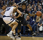 San Diego State guard Jeremy Hemsley (42) drives against Nevada forward Caleb Martin (10) in the second half of an NCAA college basketball game in Reno, Nev., Saturday, March 9, 2019. (AP Photo/Tom R. Smedes)