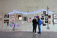 NWA Democrat-Gazette/J.T. WAMPLER David (RIGHT) and Christina Williamson of Fayetteville look at the exhibits Saturday Nov. 11, 2017 at a pop-up art show in downtown Springdale. The show was to raise money for Returning Home, an umbrella charity that helps people convicted of felonies return to society and stay out of jail. All the art was related to issues surrounding Òwomen in jailÓ in some way.
