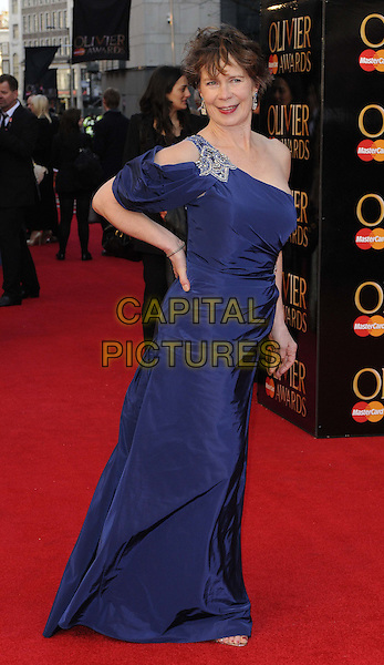 Celia Imrie.The Olivier Awards 2012, Royal Opera House, Covent Garden, London, England..April 15th, 2012.full length blue dress one shoulder hand on hip sleeve.CAP/CAN.©Can Nguyen/Capital Pictures.
