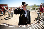 "Gene Oliver, aka ""General Geno Vino of Reno"", salutes during the National Anthem at the 51st annual International Camel Races in Virginia City, Nevada  September 12, 2010. .CREDIT: Max Whittaker for The Wall Street Journal.CAMEL"