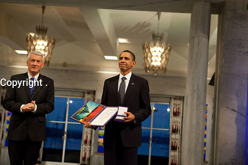 Nobel Committee Chairman Thorbjorn Jagland presents President Barack Obama with the Nobel Prize medal and diploma during the Nobel Peace Prize ceremony in Raadhuset Main Hall at Oslo City Hall in Oslo, Norway, Dec. 10, 2009. (Official White House Photo by Samantha Appleton)<br /> <br /> This official White House photograph is being made available only for publication by news organizations and/or for personal use printing by the subject(s) of the photograph. The photograph may not be manipulated in any way and may not be used in commercial or political materials, advertisements, emails, products, promotions that in any way suggests approval or endorsement of the President, the First Family, or the White House.