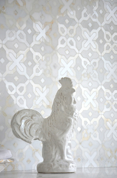 Huelva, a stone waterjet mosaic shown in honed Heavenly Cream, polished Cloud Nine, and Thassos, is part of the Miraflores collection by Paul Schatz for New Ravenna.