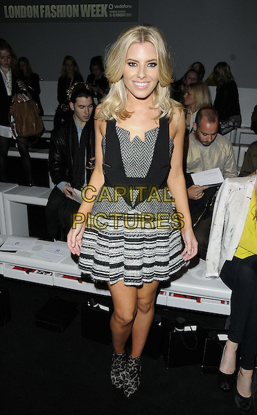 Mollie King (The Saturdays)  .at the David Koma LFW a/w 2013 catwalk show, LFW day 2, BFC Showspace, Somerset House, The Strand, London, England..February 16th, 2013.London Fashion Week full length white grey gray black pattern dress  leopard print ankle boots stripe zig zag.CAP/CAN.©Can Nguyen/Capital Pictures.