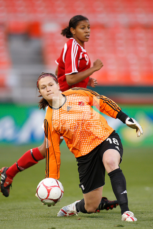 Canada goalkeeper Erin McLeod (18) distributes the ball as midfielder Candace Chapman (9) heads up field. The women's national team of the United States defeated Canada 6-0 during an international friendly at Robert F. Kennedy Memorial Stadium in Washington, D. C., on May 10, 2008.
