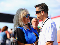 Sep 5, 2016; Clermont, IN, USA; NHRA top fuel driver Larry Dixon (right) talks with Linda Vaughn during the US Nationals at Lucas Oil Raceway. Mandatory Credit: Mark J. Rebilas-USA TODAY Sports