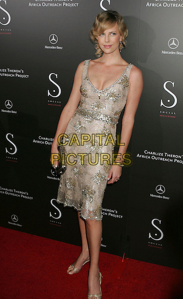 CHARLIZE THERON.Africa Outreach Program Benefit and Grand Opening of Social Hollywood at Social Hollywood, Hollywood, California, USA..June 27th, 2006.Photo: Russ Elliot/AdMedia/Capital Pictures.Ref: RE/ADM.full length gold dress clutch bag shoes.www.capitalpictures.com.sales@capitalpictures.com.© Capital Pictures.