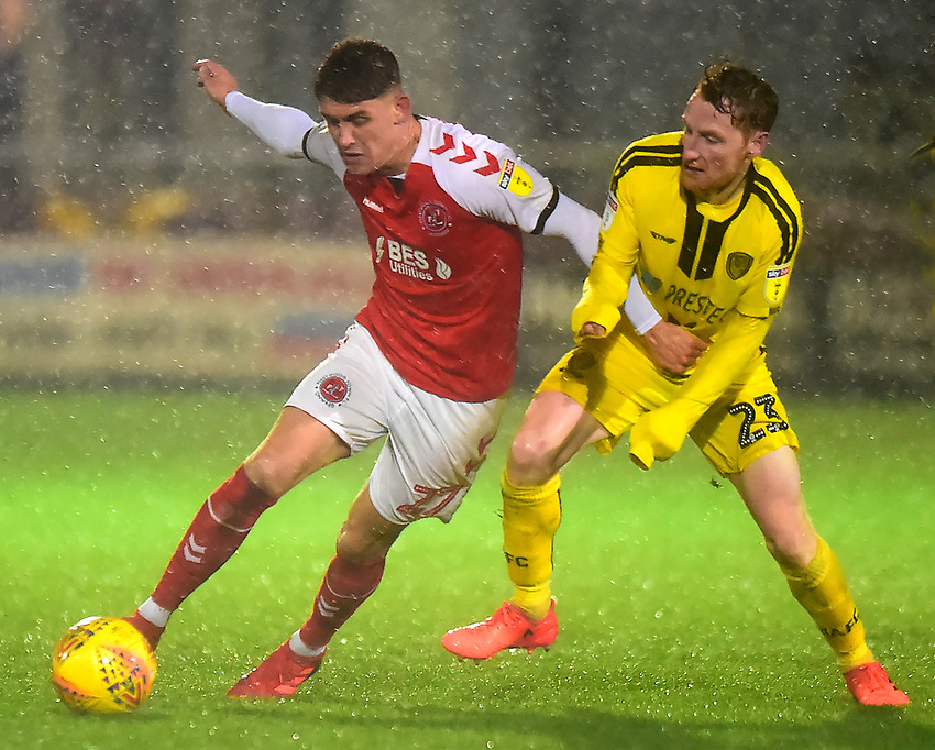 Fleetwood Town's Harrison Biggins vies for possession with Burton Albion's Stephen Quinn<br /> <br /> Photographer Richard Martin-Roberts/CameraSport<br /> <br /> The EFL Sky Bet League One - Saturday 15th December 2018 - Fleetwood Town v Burton Albion - Highbury Stadium - Fleetwood<br /> <br /> World Copyright © 2018 CameraSport. All rights reserved. 43 Linden Ave. Countesthorpe. Leicester. England. LE8 5PG - Tel: +44 (0) 116 277 4147 - admin@camerasport.com - www.camerasport.com
