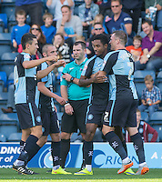Celebrations following Jason Banton (2nd right) of Wycombe Wanderers goal during the Sky Bet League 2 match between Wycombe Wanderers and Plymouth Argyle at Adams Park, High Wycombe, England on 12 September 2015. Photo by Andy Rowland.