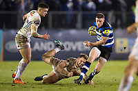 Rhys Priestland of Bath Rugby takes on the Exeter Chiefs defence. Aviva Premiership match, between Bath Rugby and Exeter Chiefs on March 23, 2018 at the Recreation Ground in Bath, England. Photo by: Patrick Khachfe / Onside Images