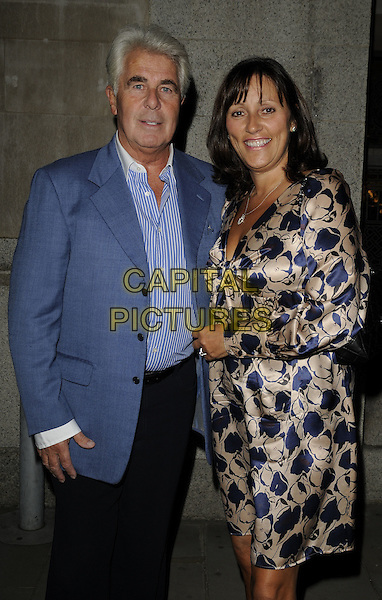 MAX CLIFFORD & JO WESTWOOD.The Inspiration Awards for Women, Cadogan Hall, Sloane terrace, London, England..October 1st, 2009.half 3/4 length blue suit jacket striped stripes shirt beige silk satin pattern dress couple.CAP/CAN.©Can Nguyen/Capital Pictures.