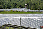A three-megawatt array occupies a rocky, untillable field across Route 2 from Hunt's farmhouse. The panels power city government in Lowell, Massachusetts, 60 miles away.