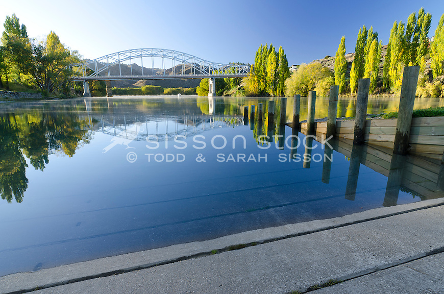 Reflection of the Alexandra Bridge over the Clutha River in early Autumn, Central Otago, South Island, New Zealand
