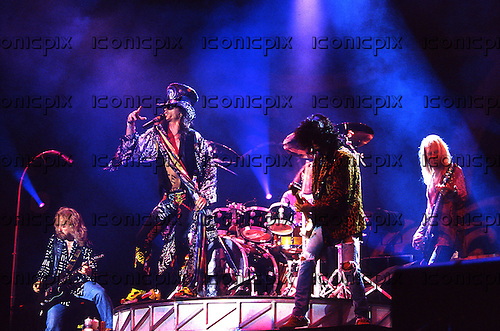 AEROSMITH - L-R: Brad Whitford, Steven Tyler, Joe Perry, Tom Hamilton - performing live on the GET A GRIP World Tour - various dates and venues - 1993-1994.  Photo credit: George Chin/IconicPix