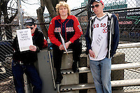 Boston Red Sox fans display signs asking for tickets for the 2011 season opener at Fenway Park in Boston, Massachusetts, USA.