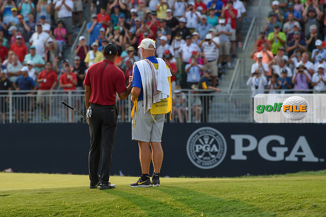 Tiger Woods (USA) sinks his birdie putt on 18 to claim second place following 4th round of the 100th PGA Championship at Bellerive Country Club, St. Louis, Missouri. 8/12/2018.<br /> Picture: Golffile   Ken Murray<br /> <br /> All photo usage must carry mandatory copyright credit (© Golffile   Ken Murray)