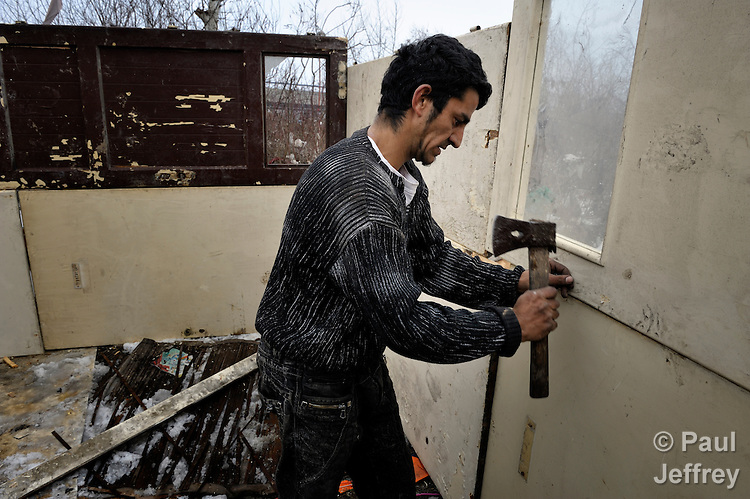 Kadral Ahmati builds a house in February 2012 to replace his home that burned in a Roma settlement in Belgrade, Serbia. The families that lived here, most of whom survive from recycling cardboard and other materials, were forcibly evicted in April 2012. Many were moved into metal shipping containers on the edge of Belgrade..