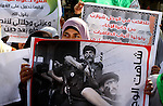 Palestinian students attend a protest against political arrests by the security forces in the West Bank, Gaza City on December 21,2010. Photo by Mohammed Asad