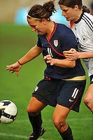 USA's Lauren Cheney fends off Germany's Kerstin Garefrekes from the ball.  The USA captured the 2010 Algarve Cup title by defeating Germany 3-2, at Estadio Algarve on March 3, 2010.